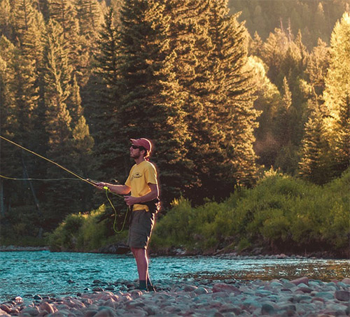 Outdoorsmen fly fishing in a mountain stream. Representing Fresno's Herb Bauer Sporting goods website.